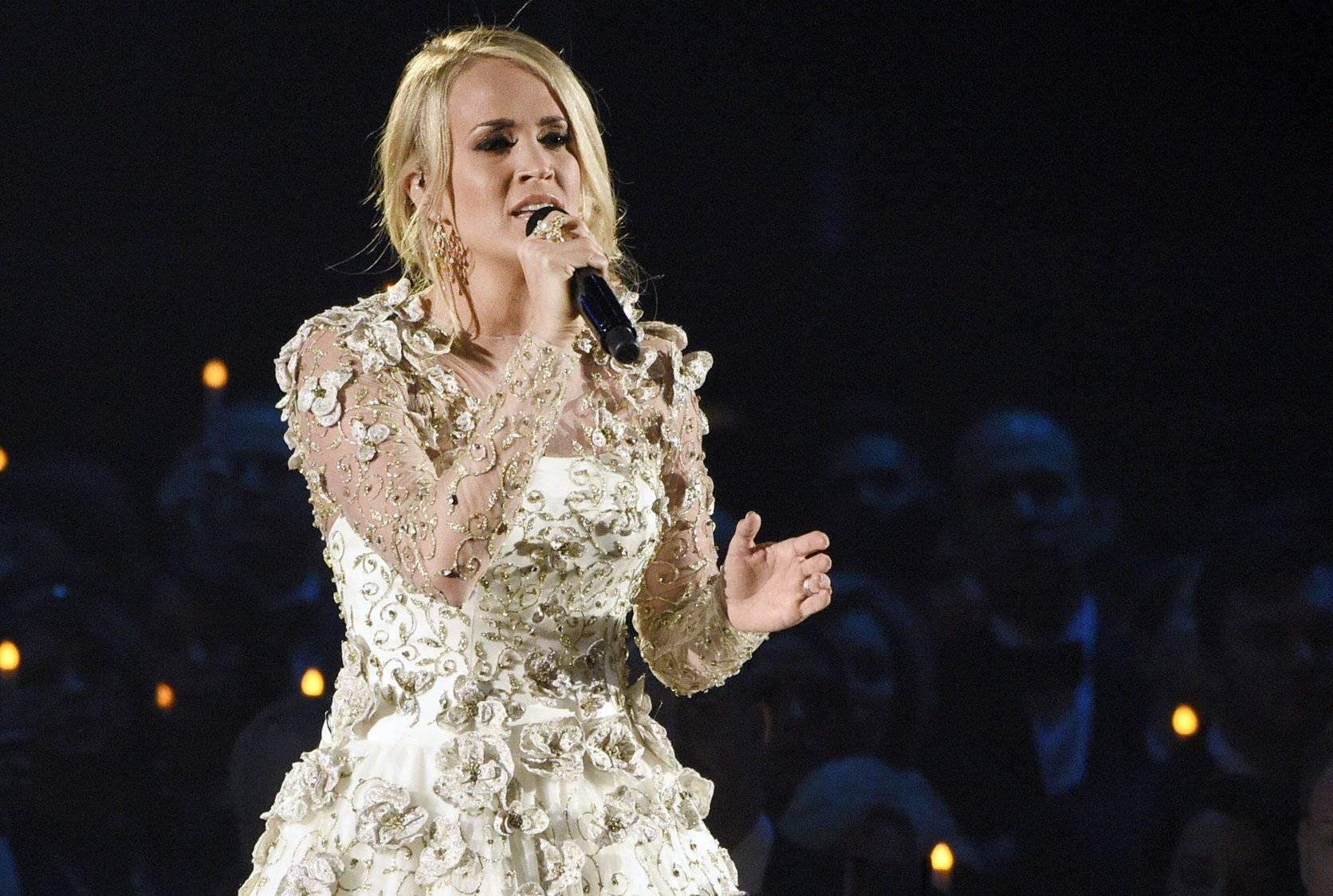 Carrie Underwood y Ludacris escriben canción para Super Bowl